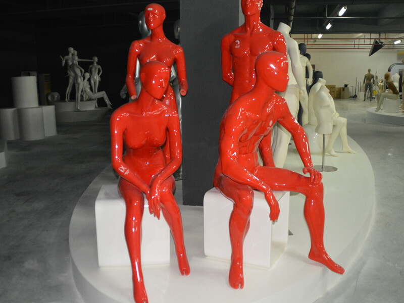 Glossy pink female and male mannequin