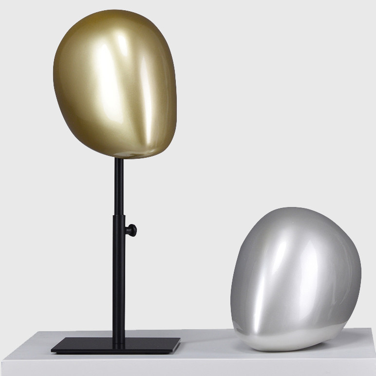 Gold and sliver color mannequin head abstract with stand