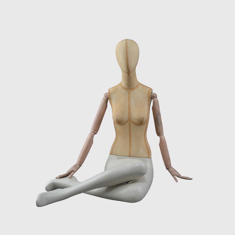 Female form mannequin sitting female mannequin